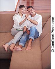 happy young romantic couple have fun and  relax at home