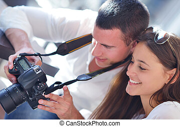 couple looking photos on camera