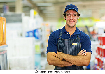 young salesman standing in hardware store