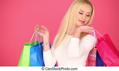 Happy young shopaholic carrying her bags - Happy attracive...