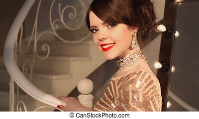 Happy young smiling girl with makeup and hairstyle, golden...