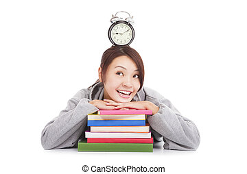 happy young student looking clock with books