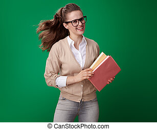 happy young student woman with books isolated on green