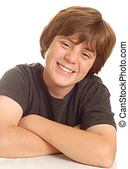 happy young teen boy with big smile isolated on white background