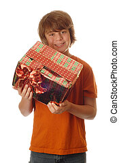 happy young teenage boy receiving present - isolated on white background