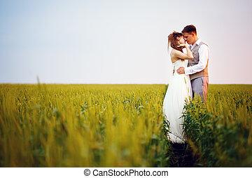 Happy young wedding couple kissing