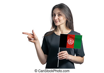 Happy young white woman holding flag Afghanistan and points to the left isolated on a white background