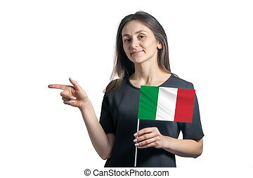 Happy young white woman holding flag Italy and points to the left isolated on a white background