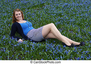 happy young woman amidst flowers