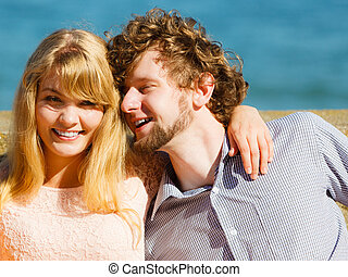 Happy young woman and man outdoor.