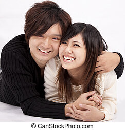 happy young woman and man smiling together