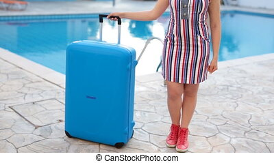Happy young woman arriving to the resort.