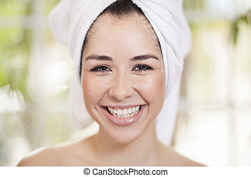 Happy young woman at a spa