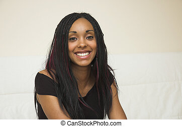 Beautiful young black woman with a winning smile.