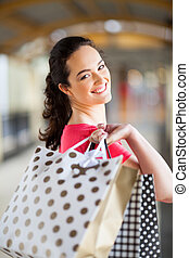 woman carrying shopping bags in mall