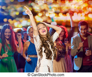 happy young woman dancing at night club - people, holidays...
