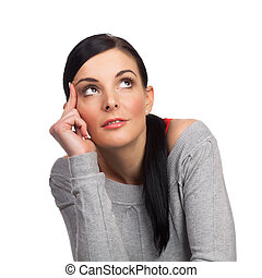 Happy young woman daydreaming isolated