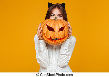 Happy young woman dressed in crazy cat halloween costume