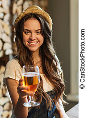 happy young woman drinking water at bar or pub