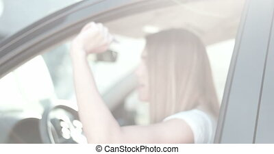 Happy Young Woman Driving