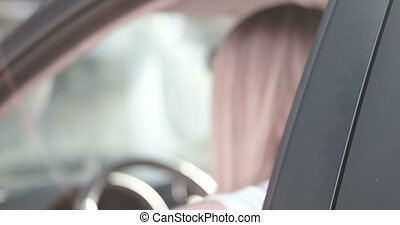 Happy Young Woman Driving Car