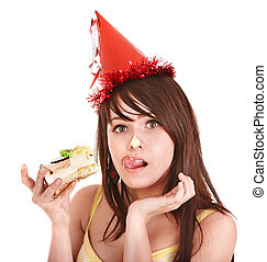Happy young woman eating cake.