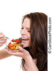 happy young woman eating salad on white background