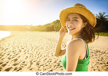 happy young woman enjoy summer vacation on the beach