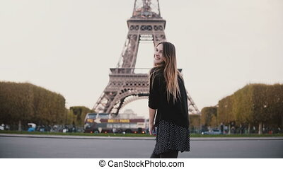 Happy young woman feeling joy because of seeing Eiffel tower...