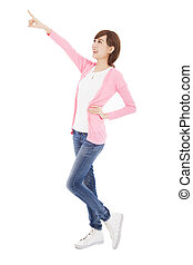 happy young woman finger pointing something