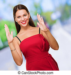 Happy Young Woman Gesturing With Hands