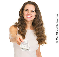 Happy young woman giving dollars
