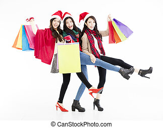 Happy young woman group enjoy Christmas shopping