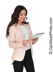happy young woman holding a tablet and smiles on white...
