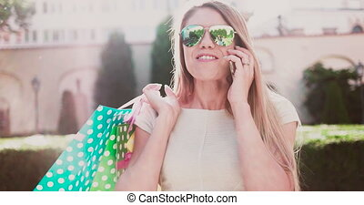 Happy Young Woman Holding Bags
