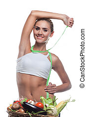Happy young woman holding basket with vegetable. Concept vegetarian dieting - healthy food