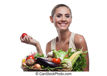 Happy young woman holding basket with vegetable. Concept ...