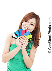 happy young woman holding credit cards
