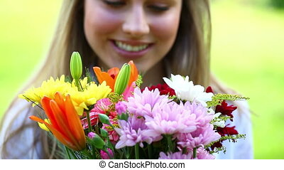 Happy young woman holding flowers