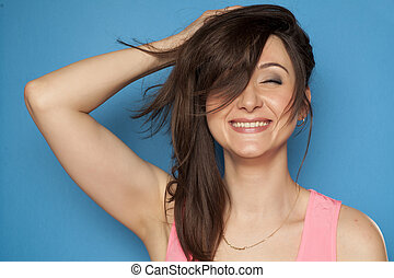 Happy young woman holding her hair