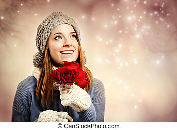 Happy young woman holding red roses