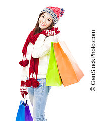 happy young woman holding shopping bags.  Christmas shopping con