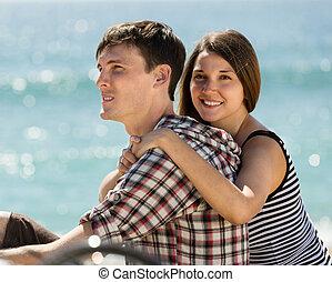 young woman hugging a man