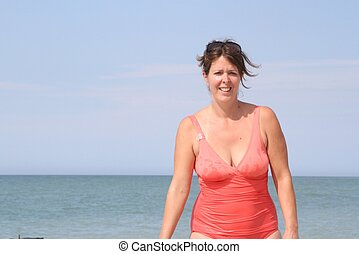 Happy young woman in a bathing suit