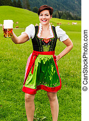 Happy young woman in a dirndl with