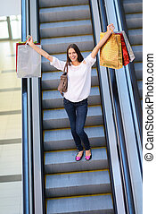 Happy young woman in a shopping mall
