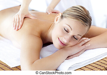Happy young woman in a spa