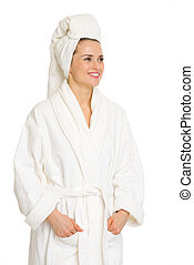 Happy young woman in bathrobe looking on copy space