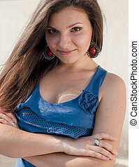 Happy young woman in blue shirt