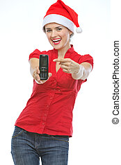 Happy young woman in Christmas hat pointing on mobile phone